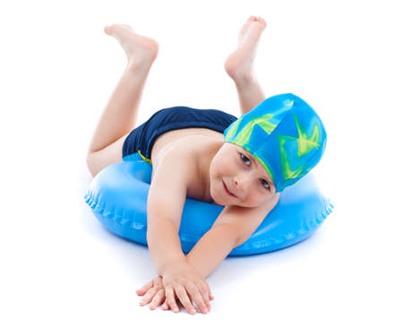 float: Little boy playing with blue life ring in swim caps, isolated in white Stock Photo