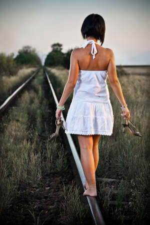 picture of young woman on the railway  photo