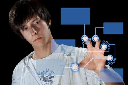 Man pressing digital button, futuristic technology in black background Stock Photo - 10507874