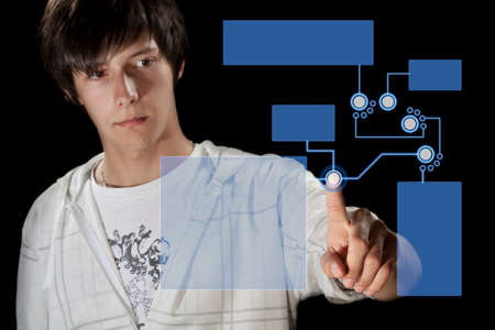 Man pressing digital button, futuristic technology in black background photo