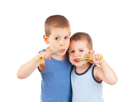 Young boys brushing his teeth with toothbrush, isolated in white Stock Photo - 10508072