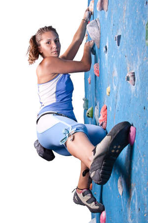 carabineer: Athletic girl climbing on an indoor rock-climbing wall  Stock Photo