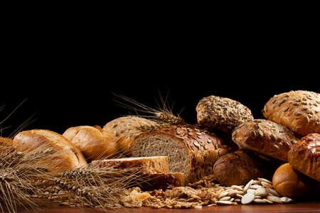 baked  goods: Assortment of baked goods in black background Stock Photo