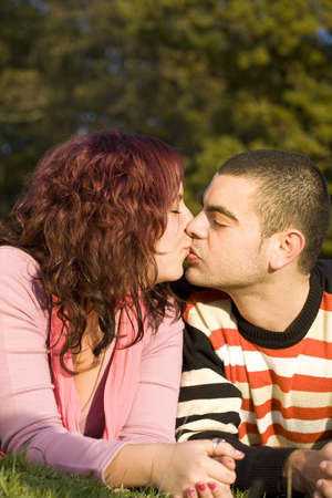 Beautiful couple about to kiss outdoor photo