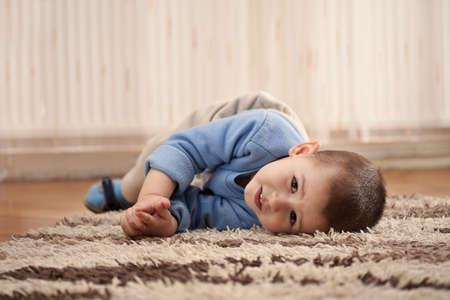 one parent: a happy smiling boy playing and having fun at home  Stock Photo