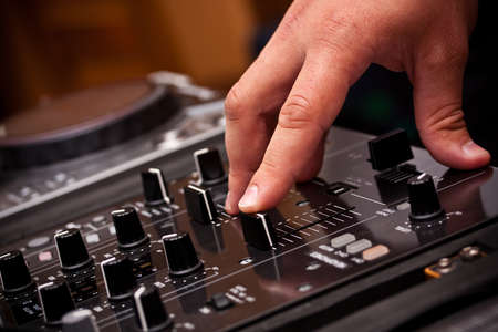 DJ play music with music mixer Stock Photo - 10501780