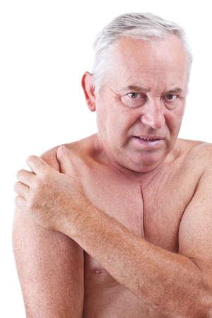 Senior man holding his shoulder, having ache  photo