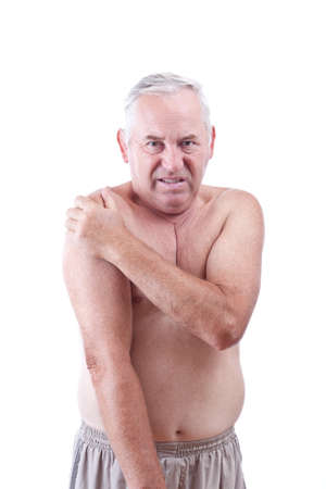 senior pain: Senior man holding his shoulder, having ache  Stock Photo