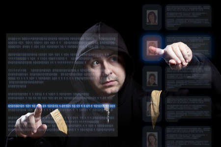 hacker working on modern technology, focus on the hand Stock Photo - 10770075