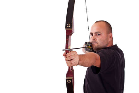 Young man in black shirt holding bow and shooting to target isolated in white photo