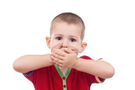 to say: Little boy covering her mouth with her hand  Stock Photo