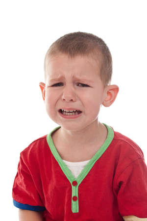 expression facial: Closeup of a crying boy, studio shot, isolated on white Stock Photo