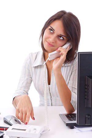 Portrait of charming young business woman on phone call at office  photo