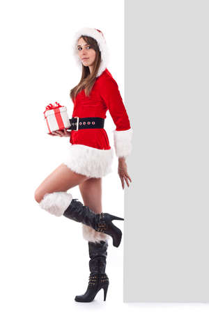 Christmas girl in santa hat with banner photo