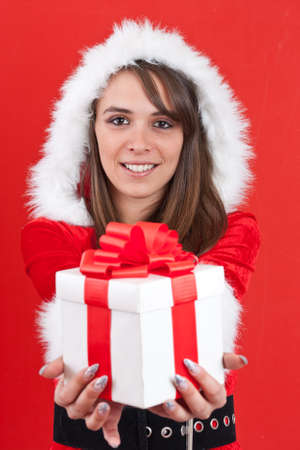 Sexy Woman with Santa Hat and Christmas Gifts in red background photo