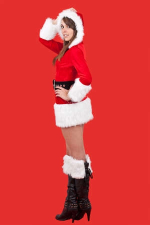 Beautiful and sexy woman wearing santa clause costume with giftbox photo