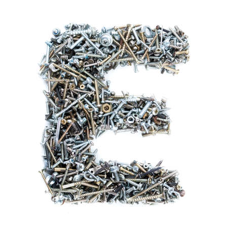 metal fastener: Letter E made of screws isolated in white background