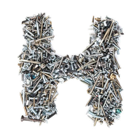 Letter H made of screws isolated in white background photo
