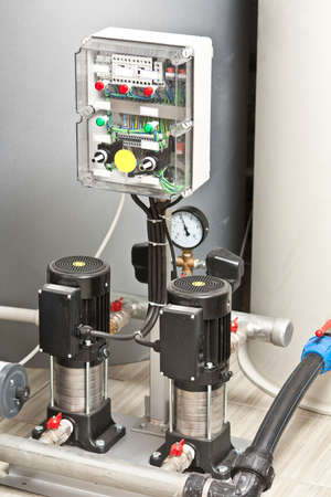 burner: Modern boiler room equipment for heating system. Pipelines, water pump, manometers.