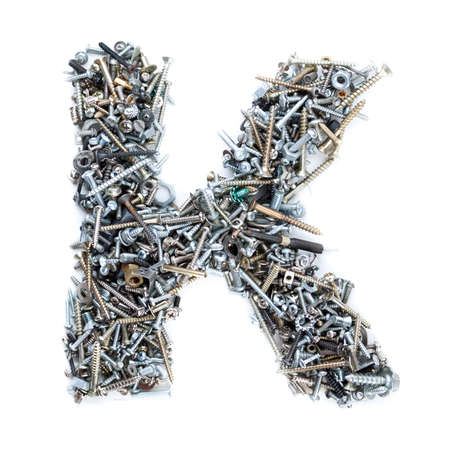 Letter K made of screws isolated in white background photo