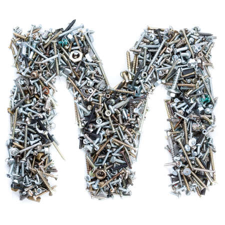 metal fastener: Letter M made of screws isolated in white background