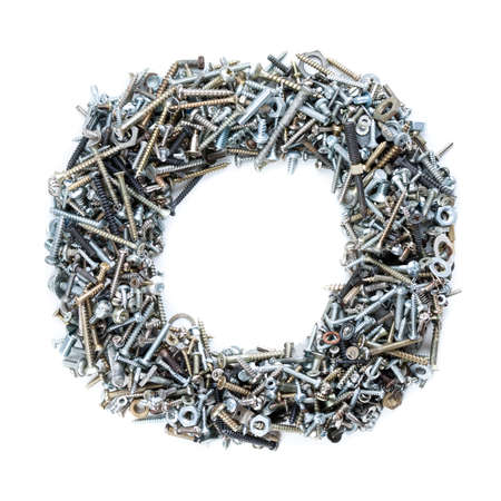 Letter O made of screws isolated in white background photo