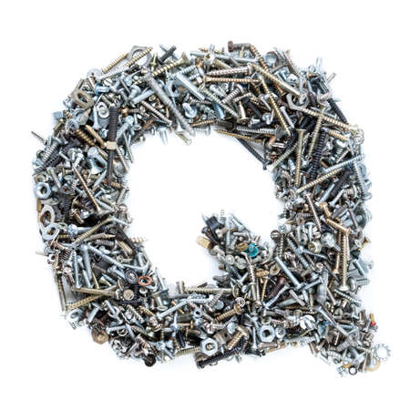 Letter 'Q' made of screws isolated in white background photo