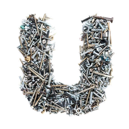 Letter U made of screws isolated in white background photo