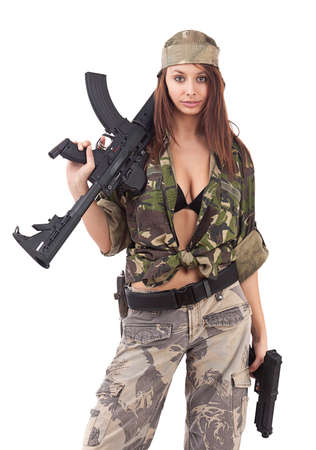 sexy army: Young woman soldiers posing with guns, isolated on white background