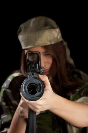 Young woman soldiers with guns, isolated on black background photo
