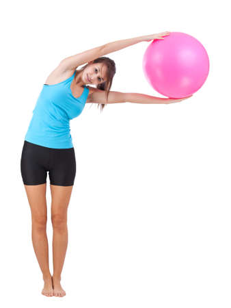 Fitness girl holding and posing with fitness ball Stock Photo - 12384564