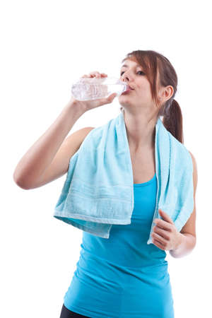 Portrait of attractive girl isolated on white studio shot drinking water  photo