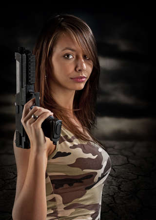 Sexy woman bodyguard holding gun