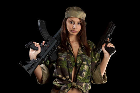 The beautiful girl with a rifle on a black background  photo