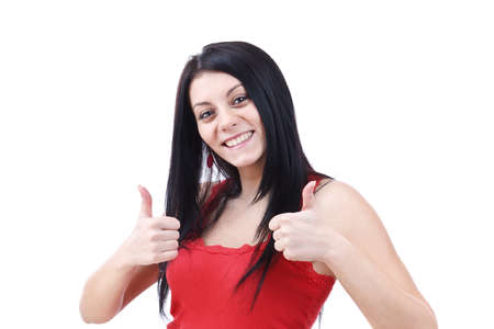 Portrait of beautiful young woman gesturing a yes sign on white background  photo