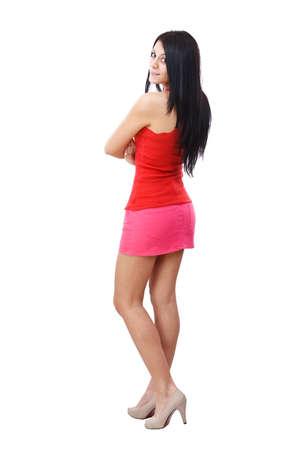 mini skirt: Belle femme posant en jupe courte. Isol� sur fond blanc Banque d'images