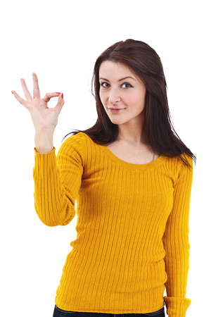 Portrait of beautiful young woman gesturing a okay sign on white background Stock Photo - 12762801