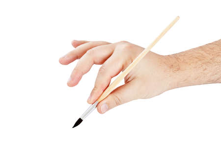 Brush to paint in his hand on a white background  photo