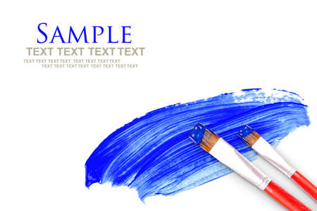 artists paint brush and blue paint