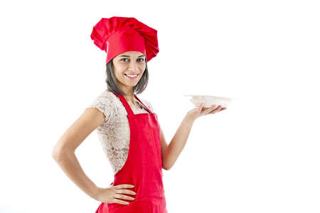 Portrait of female in chef uniform and chef hat showing plate photo