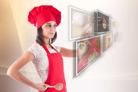 Woman dressed as a cook selecting images Stock Photo - 12762709