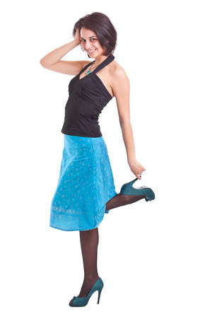 Full length portrait of a beautiful young woman posing in a funky blue dress against in white background photo