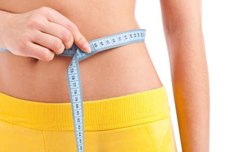 Woman measuring perfect shape of beautiful thigh. She lose weight Stock Photo - 12762811