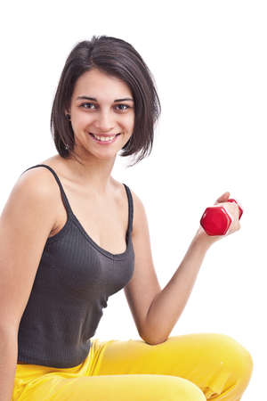 Fit fitness girl smiling happy lifting weights looking strength training shoulder muscles.  photo