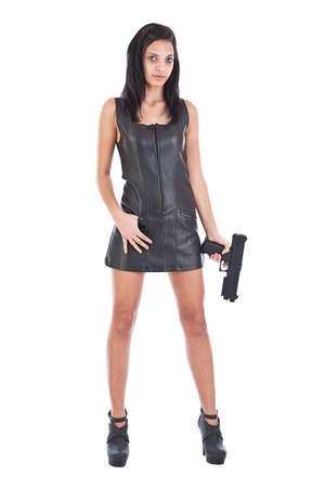 Sexy girl in black leather with gun