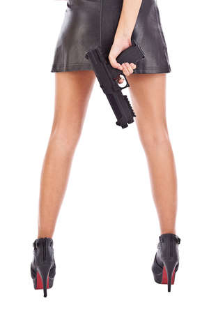 The body of a young woman with a pistol. Isolated on white background.