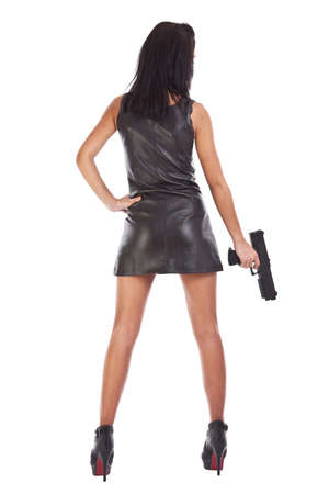 Elegant fashionable woman with a gun in hands  photo