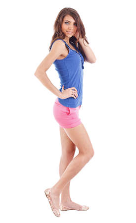 full height: Portrait of smiling young beautiful woman in shorts at full heigh Stock Photo