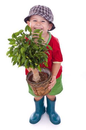 Little gardener boy, isolated on white Stock Photo