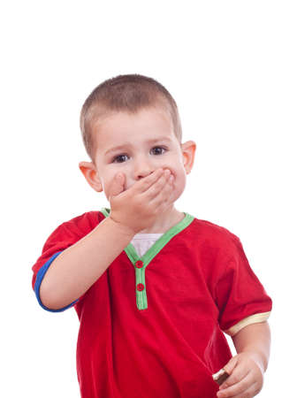Little boy covering her mouth with her hand  photo